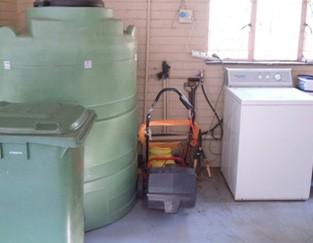 Plastic fuel tank utility area